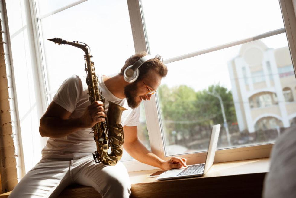 Man Playing Music On Laptop